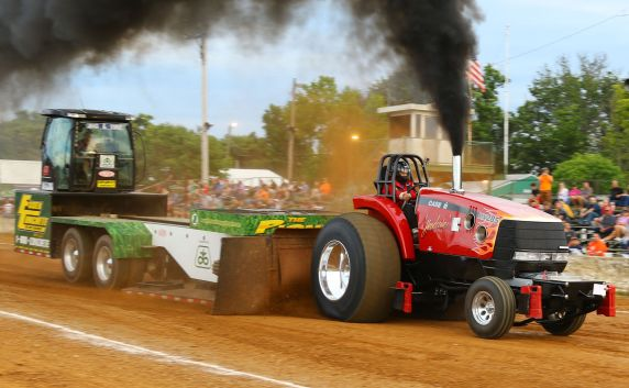 Case International Harvester tractor pulling Pioneer Seed Sled
