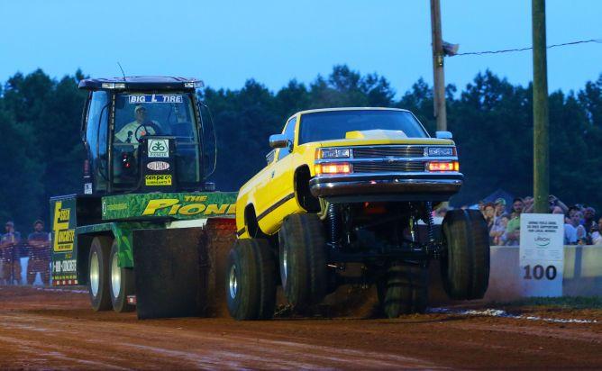Chevrolet truck pulling Pioneer Seed Sled