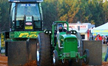 John Deere tractor pulling Pioneer Seed Sled